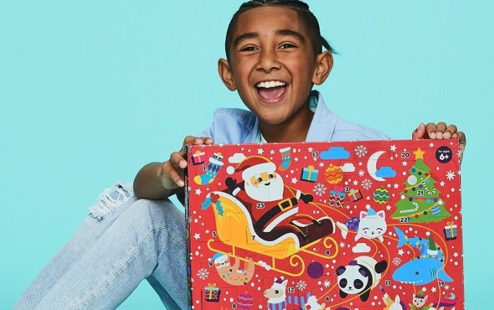 A young person holding the Smiggle advent calendar.