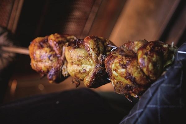 Three chickens on a pole