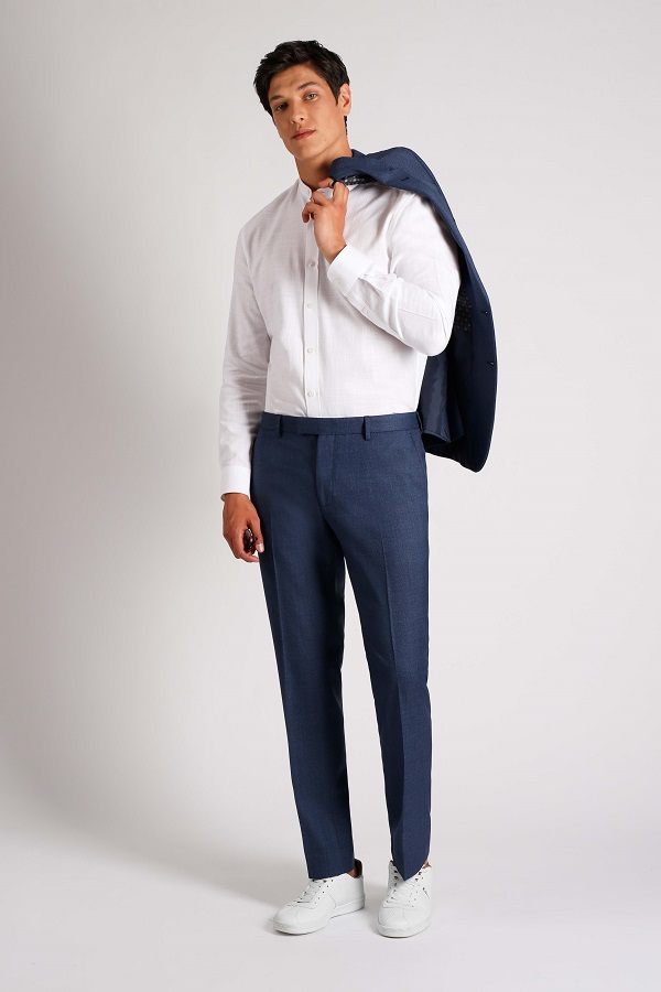 A man wearing a white shirt and blue trousers from SD