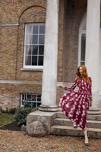 woman in burgundy floral print hobbs long dress