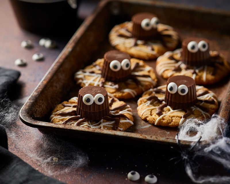Cookies topped with chocolate with eye shaped icing.