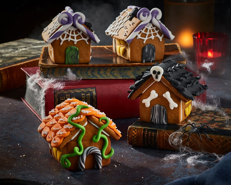 Gingerbread house decorated with icing.