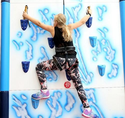 A person climbing a wall at Rock Up