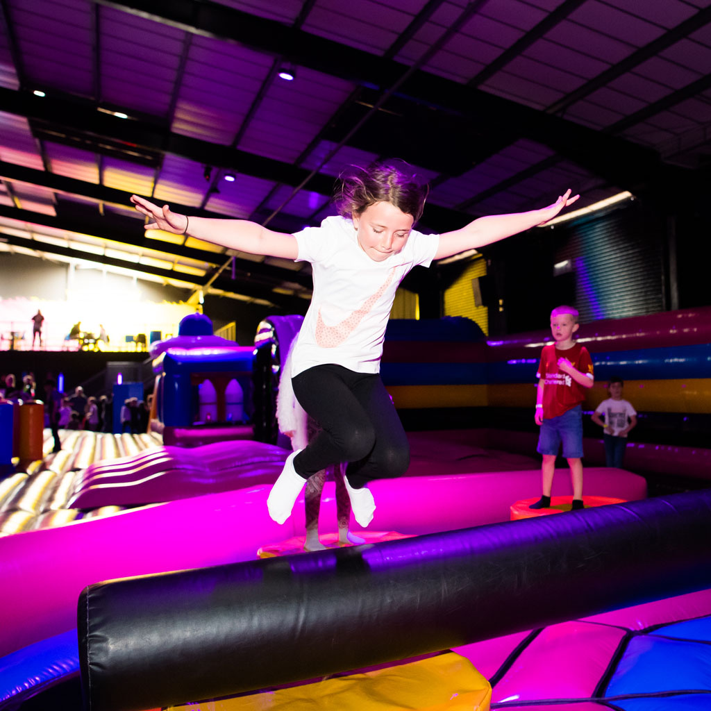 image of girl bouncing on inflatables.