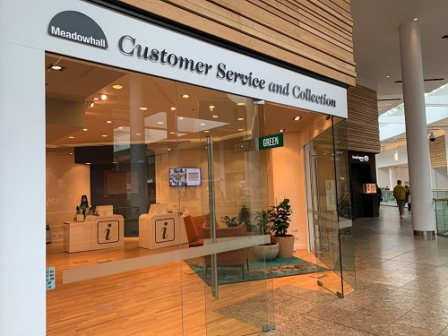A store sign saying Meadowhall Customer Service and Collection.