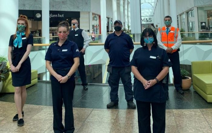 A group of Meadowhall staff wearing facemasks.