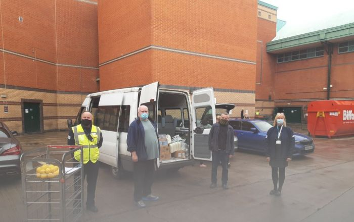 4 workers stood outside a van in the loading bay of Meadowhall