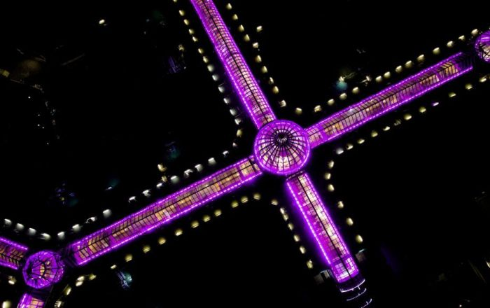 Aerial image of meadowhall lit up in purple.