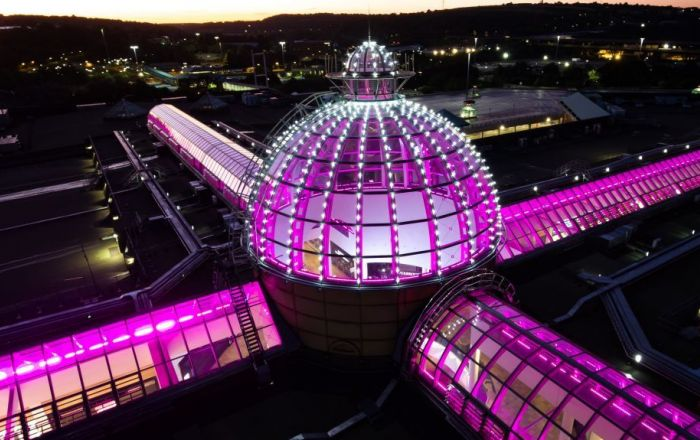 Meadowhall dome lights lit up in pink.