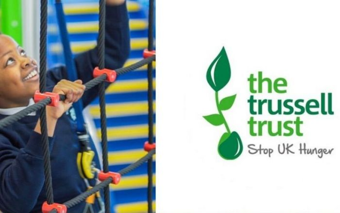 The Trussell Trust Logo on the right and an image of a young boy climbing rope at Rock Up