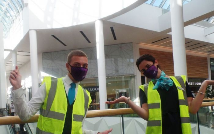 Two members of Meadowhall staff wearing facemasks.