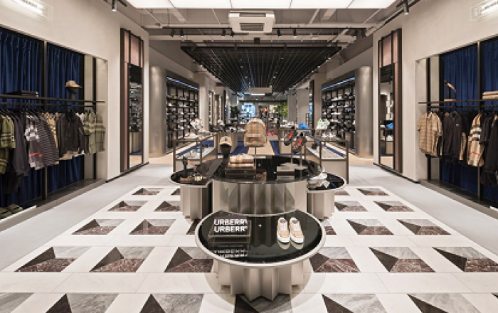 Interior of flannels clothing department with Burberry clothes on display.