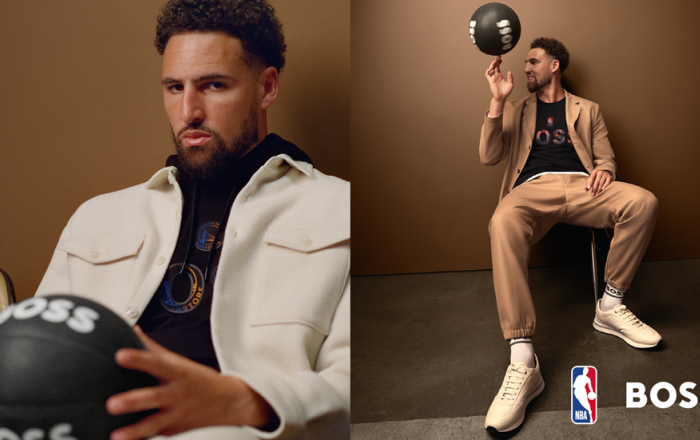 A man wearing boss clothing and holding a basketball