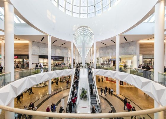 central dome area inside Meadowhall with two escalators.