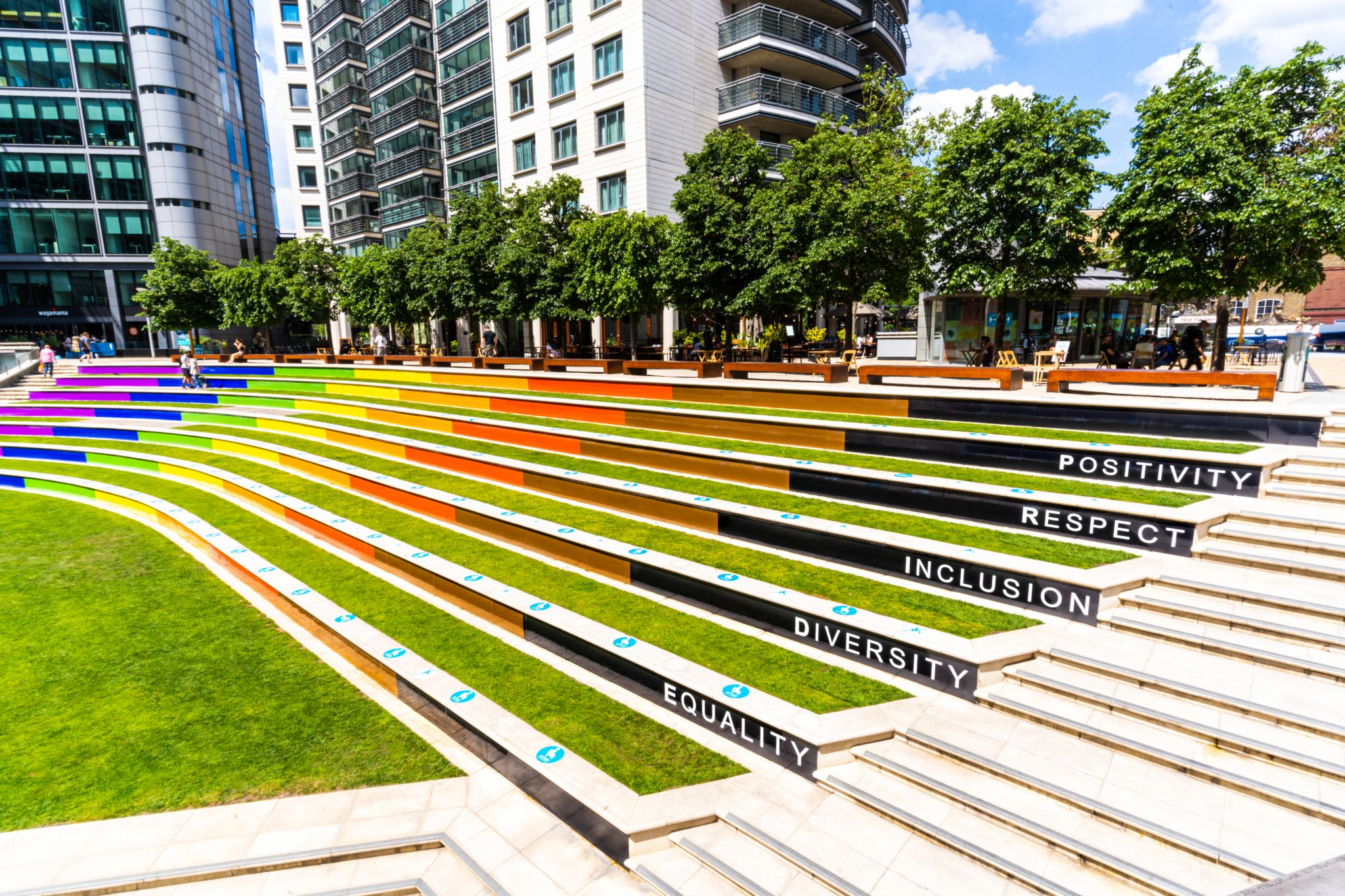 The Pride colours painted steps at Paddington Central