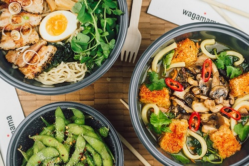 An aerial image of three takeaway bowls of wagamama food.