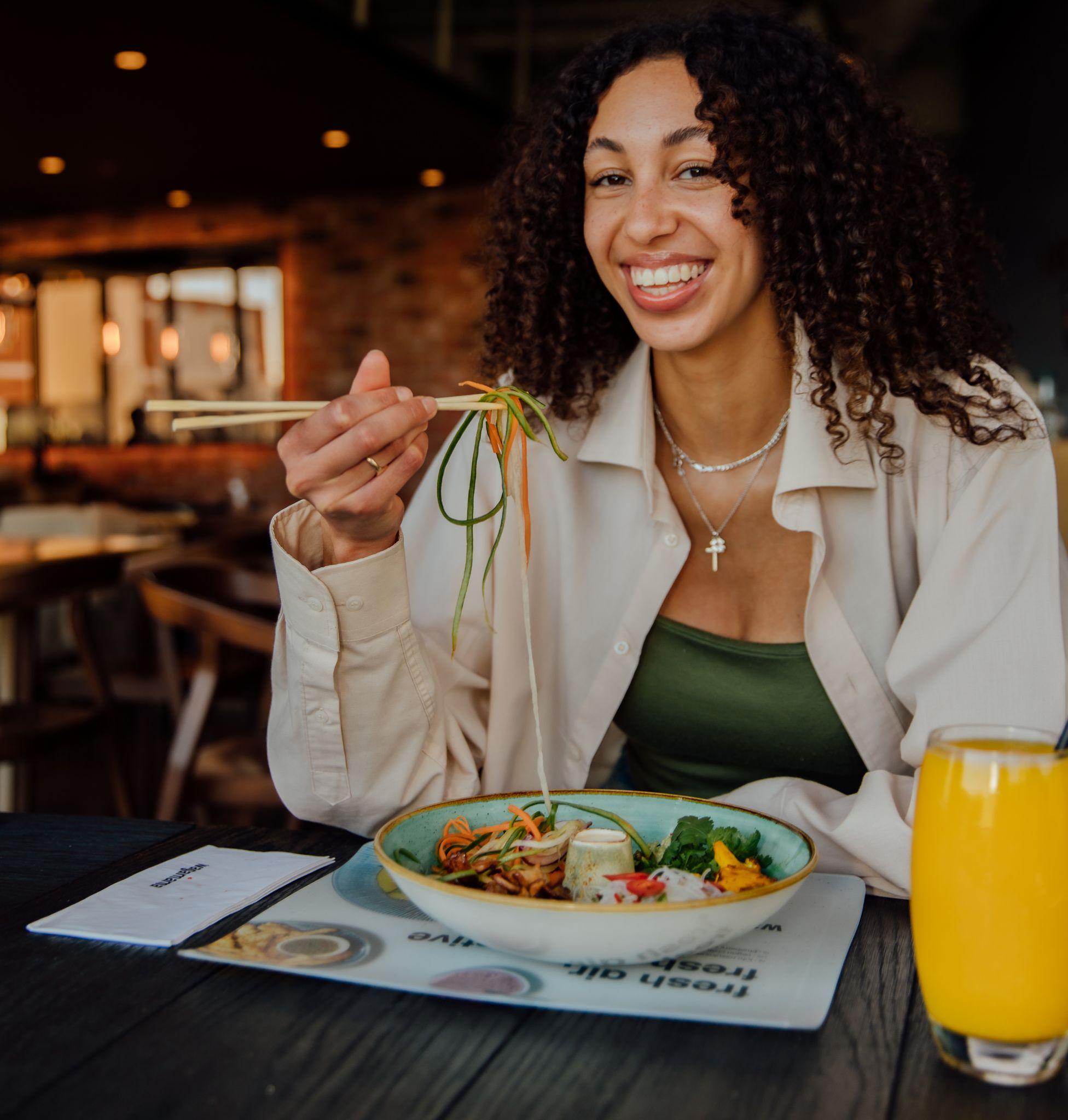 woman eating at wagamama