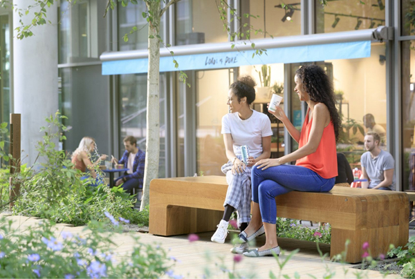 two women sat on a bench outside Lord of Poke store front
