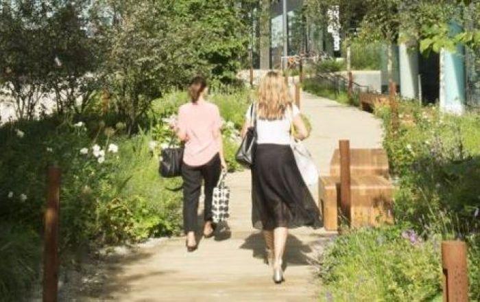 Two women walking to work at Paddington Central