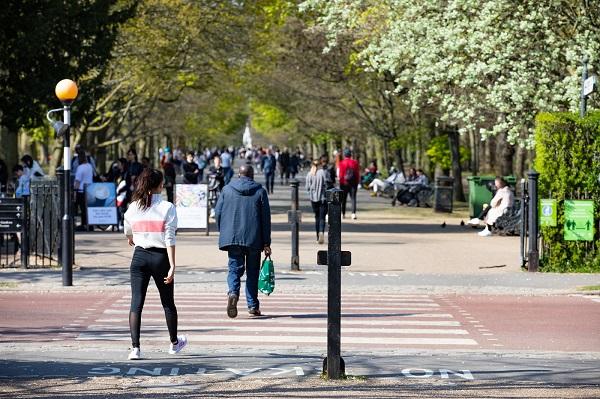 People walking across a zebra crossing at Regent's Park.