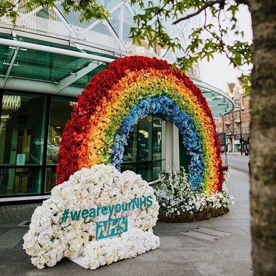 Flowers assorted in a rainbow with hashtag #weareyourNHS