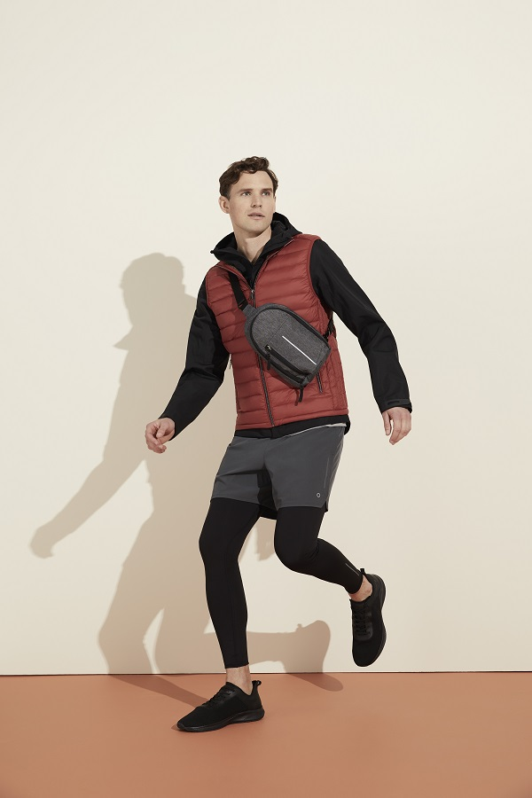 A man wearing a jacket, gilet, shorts and leggings from m&s