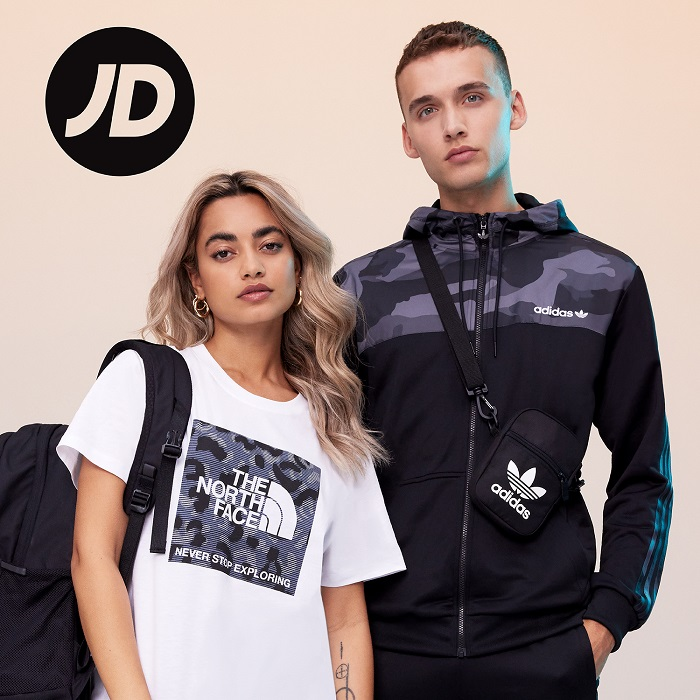 Two people wearing sports clothing and the JD logo in the corner.