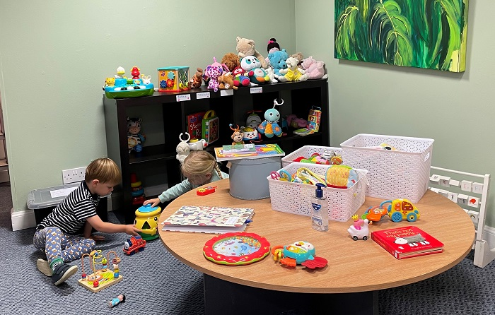 children playing in a room with toys.