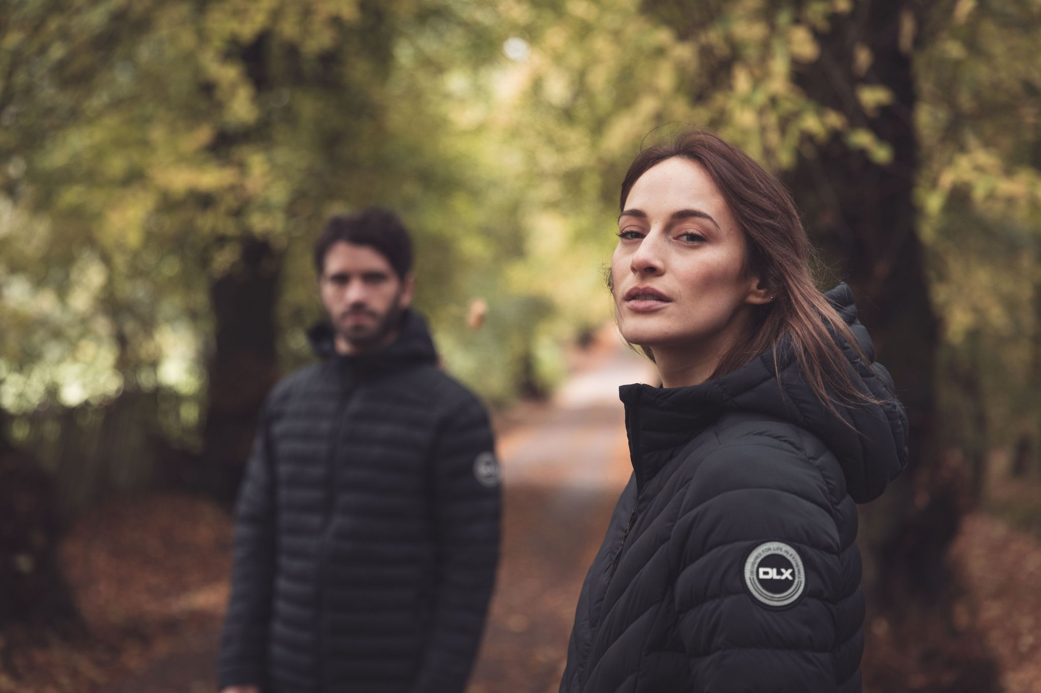 male and female model wearing DLC ECO black coats