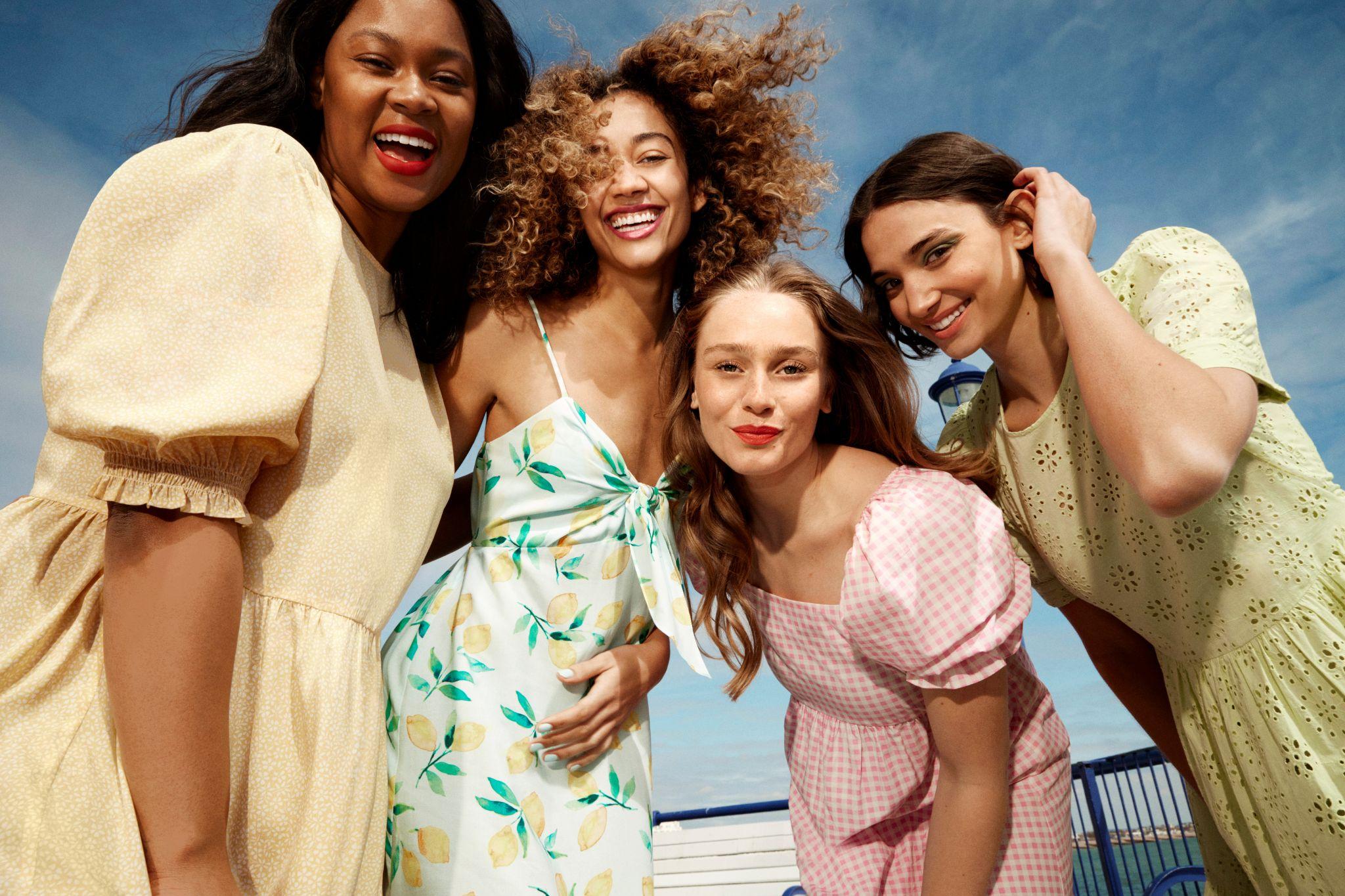 4 women wearing dresses from New Look