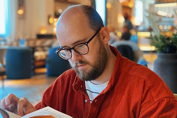 A man looking at a menu.
