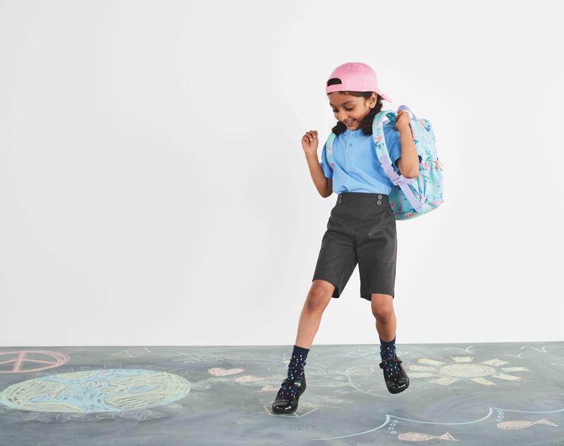 A school girl wearing M&S uniform.
