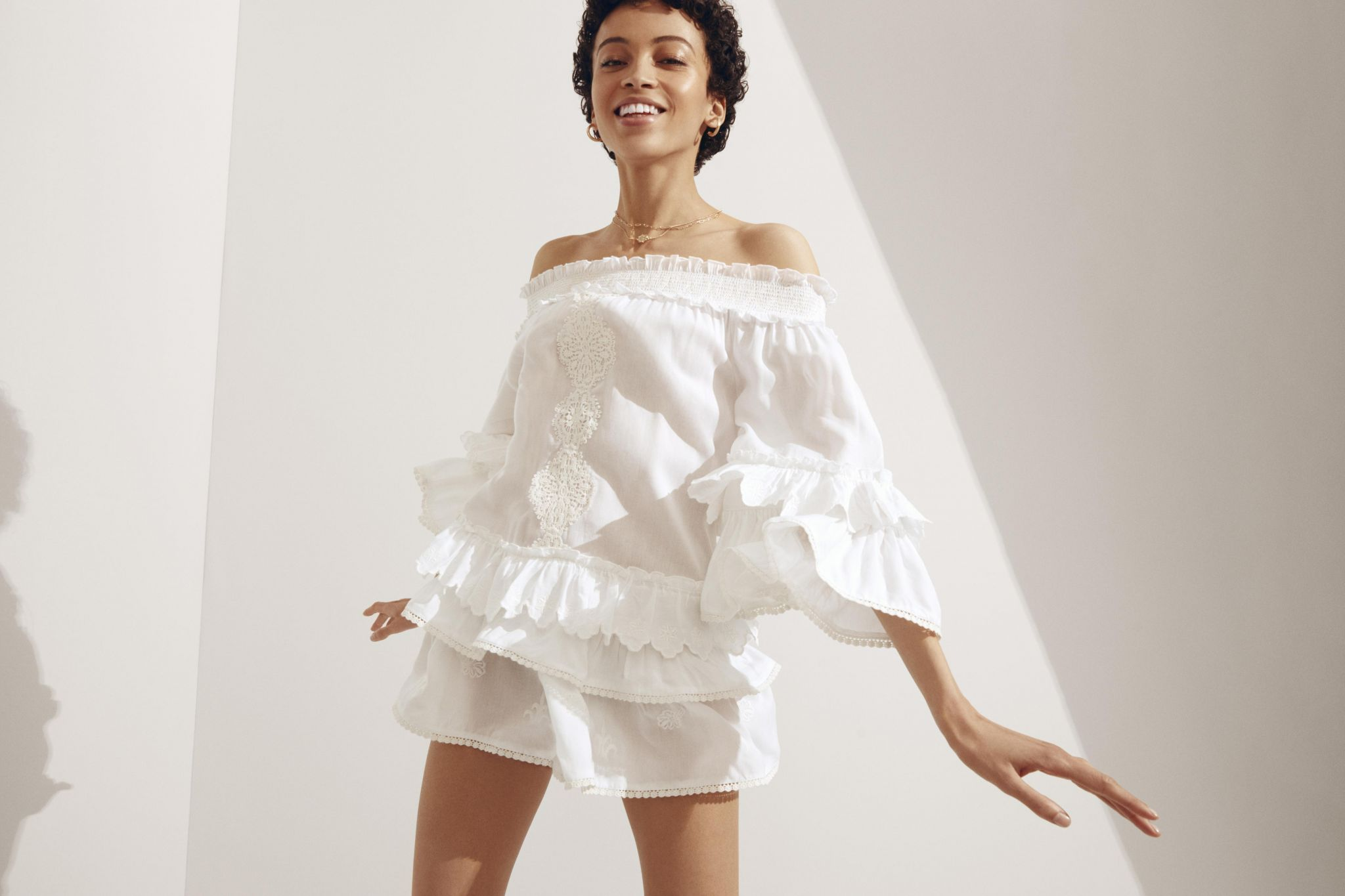River Island model in white dress
