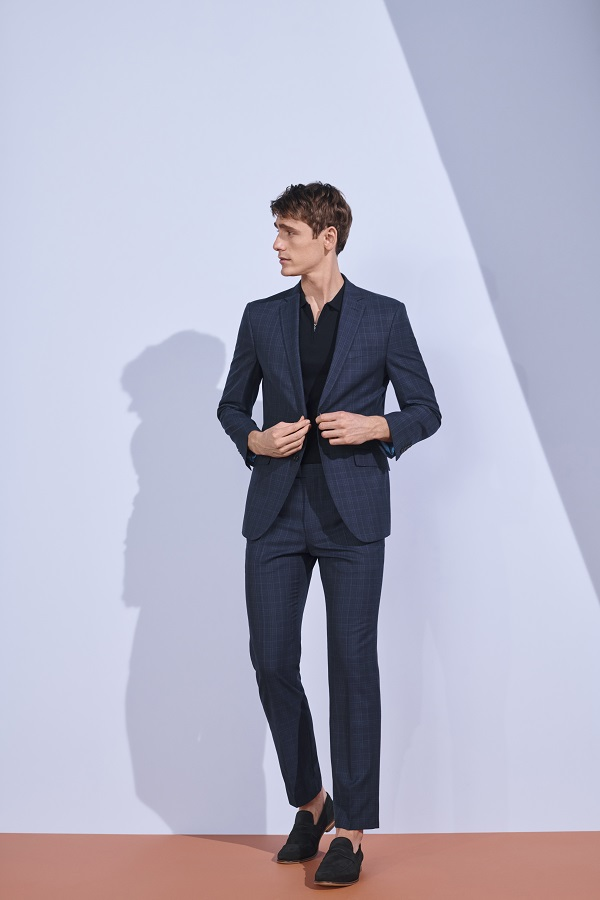 A man wearing a blue suit from M&S