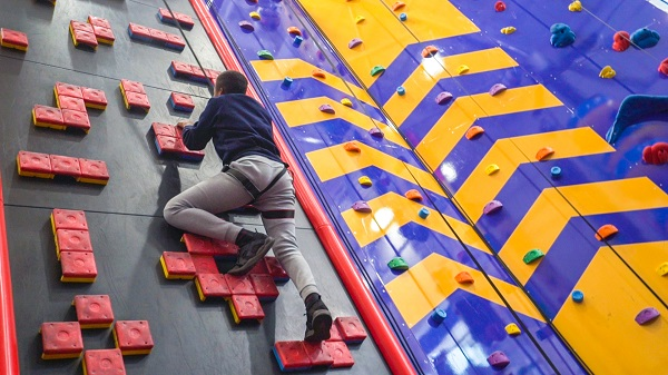 A view of a man climbing a wall at Rock Up.