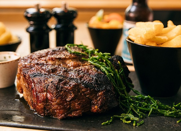 Close up image of steak on a plate.