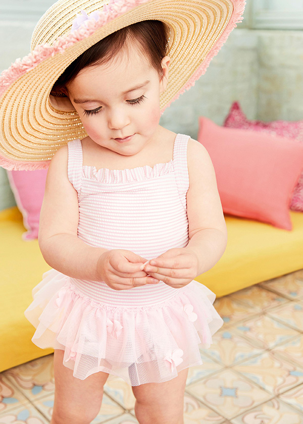 Young girl in straw hat and beachwear from Monsoon