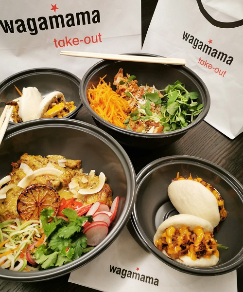 Four takeaway bowls with various food items in and a takeout Wagamama bag and chopsticks.