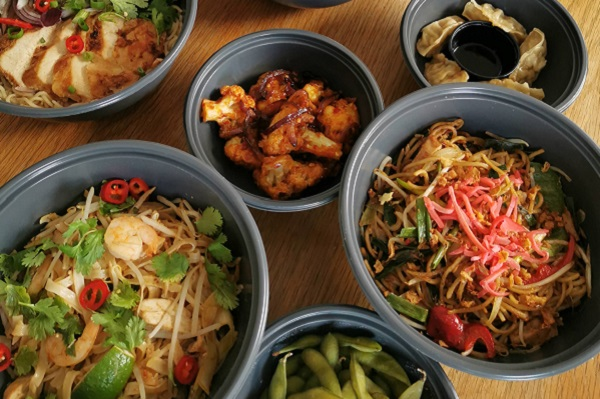 Wagamama takeaway food in bowls.